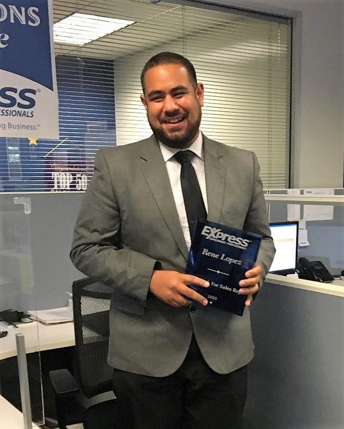 Rene Lopez holdiing his Sales Fast-Track Award
