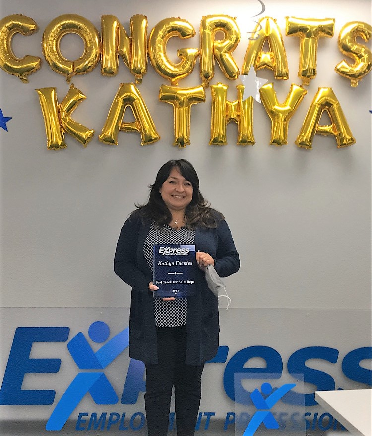 Kathya Fuentes, Thousand Oaks Staffing Agency Sales Rep Holding Award