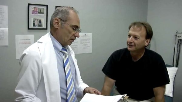 Dr. Cherkassky Medical Weight Loss Doctor in Dallas TX with a patient